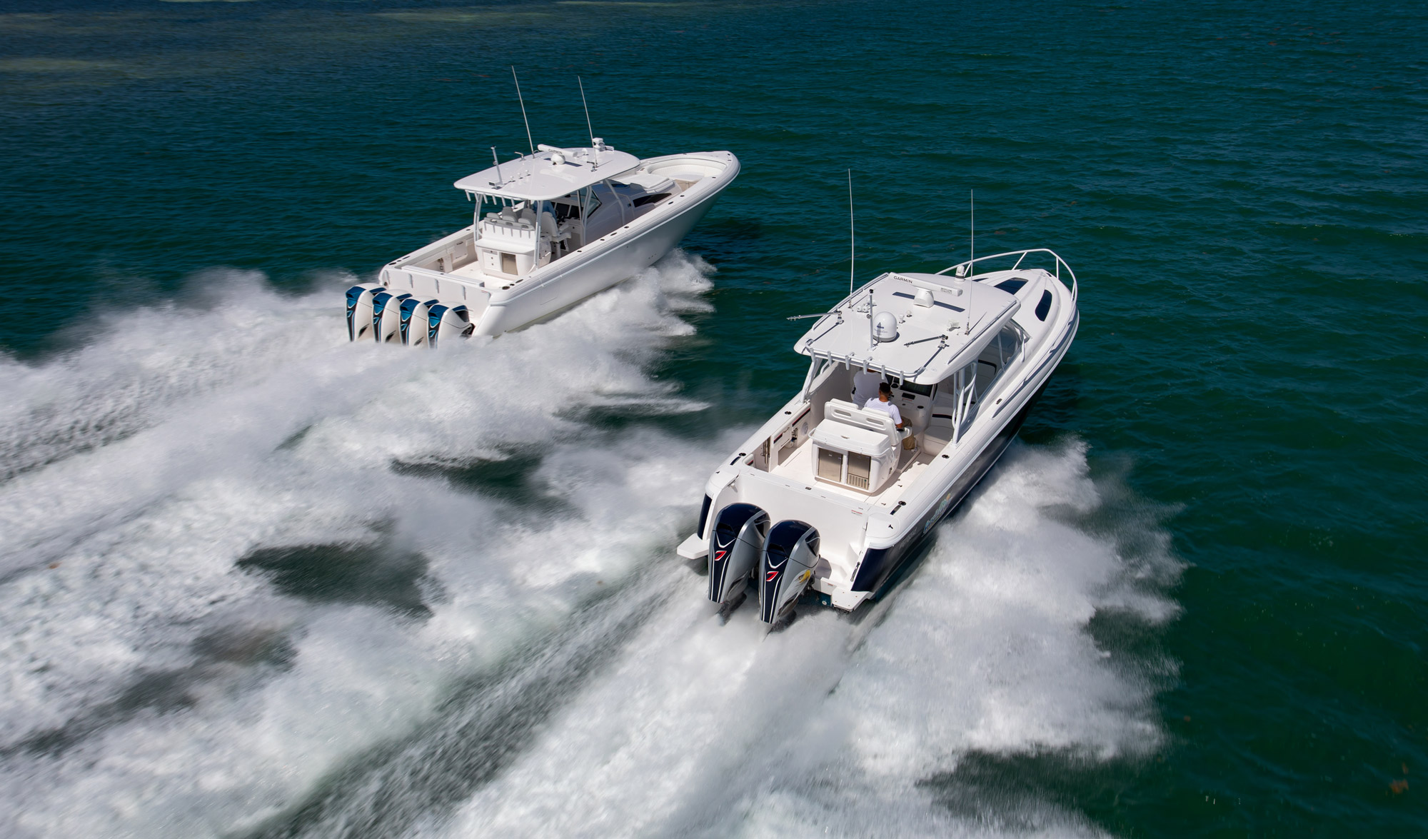 Two boats side by side with seven marine CE Mark Certification motors